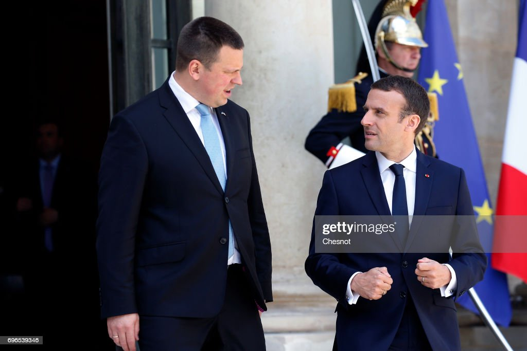 French President Emmanuel Macron (R) accompanies Estonian President, Juri Ratas after their meeting at the Elysee Presidential Palace on June 16, 2017, in Paris France. Ratas is on an official visit to Paris.