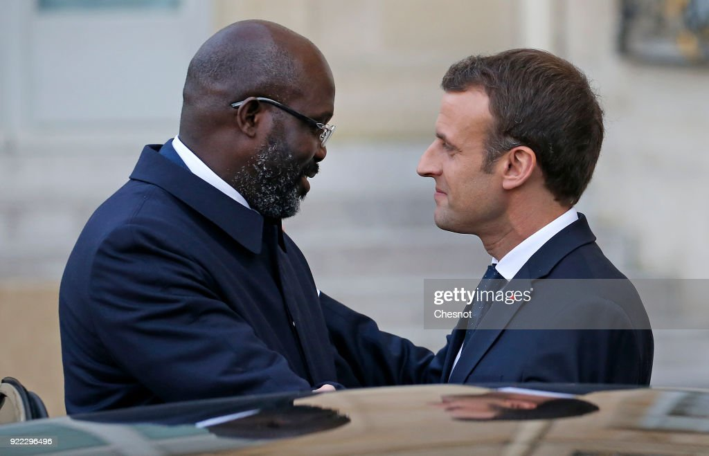 French President Emmanuel Macron accompanies Liberia's President George Weah after their lunch meeting at the Elysee Palace on 21 February, 2018 in Paris, France. Weah is a former international soccer player and was elected President of the Republic of Liberia on January 22, 2018, he is currently on an official visit to France.