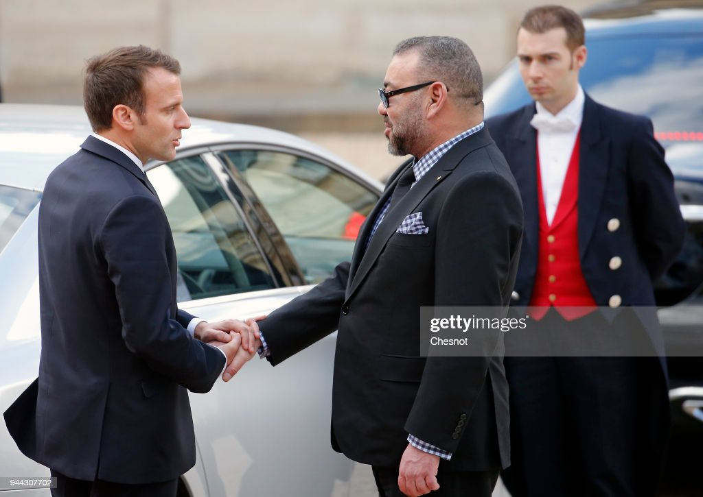 French President Emmanuel Macron accompanies Morocco's King Mohammed VI after their meeting at the Elysee Presidential Palace on April 10, 2018 in Paris, France. King Mohammed VI is in Paris for an official visit.
