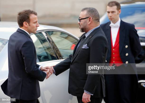 French President Emmanuel Macron accompanies Morocco's King Mohammed VI after their meeting at the Elysee Presidential Palace on April 10 2018 in...