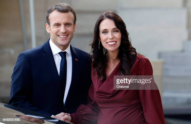 French president Emmanuel Macron accompanies New Zealand's Prime Minister Jacinda Ardern after their meeting at the Elysee Palace on April 16 2018 in...