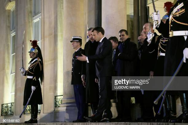 French President Emmanuel Macron accompanies out Turkish President Recep Tayyip Erdogan after their meeting on January 5 at the Elysee Palace in...