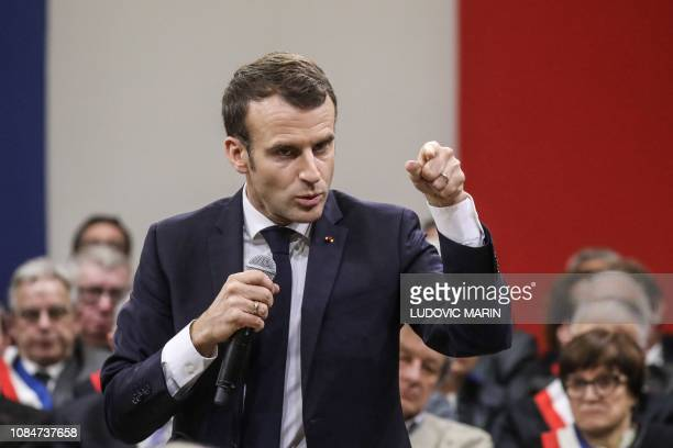 French President Emmanuel Macron addresses a meeting with some 600 mayors of Occitania to relay their constituent's grievances on January 18, 2019 in...