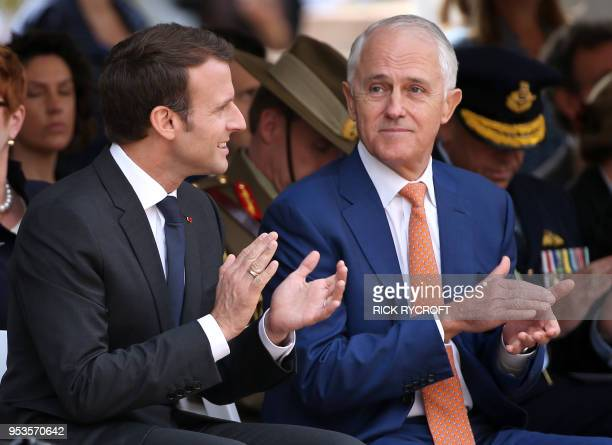 French President Emmanuel Macron and Australian Prime Minister Malcolm Turnbull clap during war commemorative ceremony in Sydney on May 2 2018 Macron...