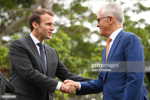 French president Emmanuel Macron and Australian Prime Minister Malcolm Turnbull shake hands on May 2 2018 in Sydney Australia President Macron is on...