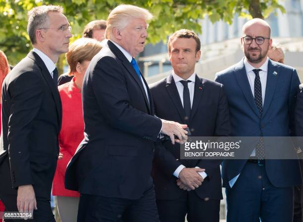 French President Emmanuel Macron and Belgian Prime Minister Charles Michel look on as NATO Secretary General Jens Stoltenberg and US President Donald...