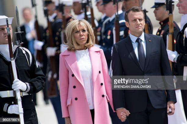 TOPSHOT French President Emmanuel Macron and Brigitte Macron listen to the US and French national anthems after arriving at Joint Base Andrews in...