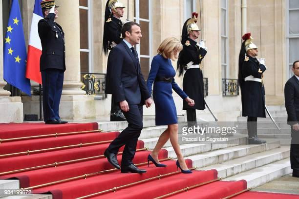 French President Emmanuel Macron and Brigitte Macron walk in the courtyard of Elysee Palace on March 19 2018 in Paris France GrandDuke Henri Of...