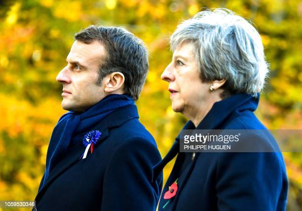 French President Emmanuel Macron and Britain's Prime Minister Theresa May attend a ceremony marking the 100th anniversary of the end of the World War...