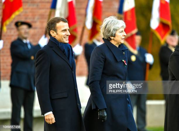 French President Emmanuel Macron and Britain's Prime Minister Theresa May take part in a ceremony marking the 100th anniversary of the end of the...
