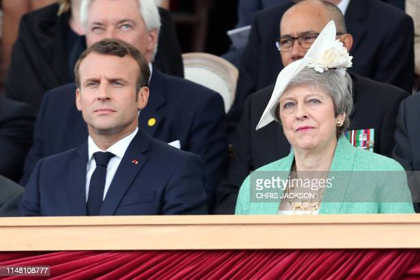 French President Emmanuel Macron and Britain's Prime Minister Theresa May attend an event to commemorate the 75th anniversary of the DDay landings in...
