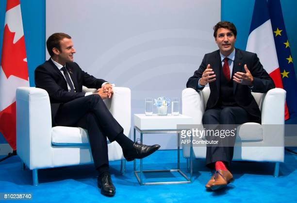 French President Emmanuel Macron and Canadian Prime Minister Justin Trudeau speak during a bilateral meeting on the opening day of the G20 summit in...