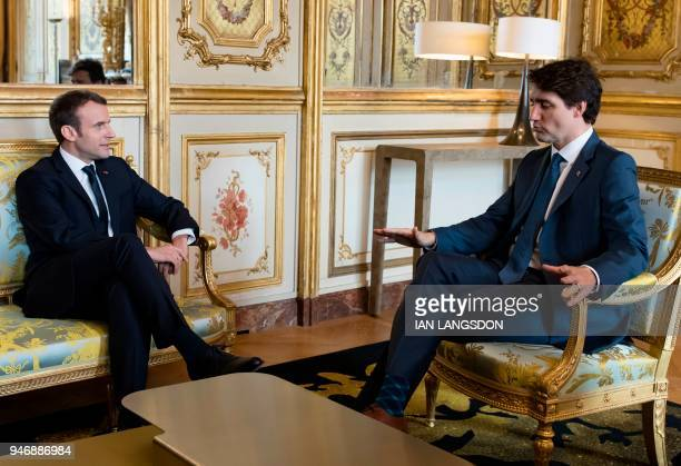 French President Emmanuel Macron and Canadian Prime Minister Justin Trudeau hold a meeting at the Elysee Palace in Paris on April 16 2018 Prime...