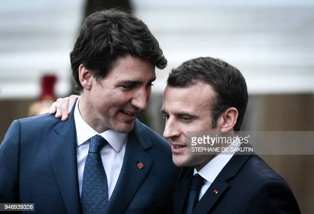 French President Emmanuel Macron and Canadian Prime Minister Justin Trudeau talk as Macron escorts him following their meeting at the Elysee Palace...