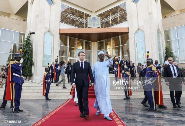 French president Emmanuel Macron and Chad's president Idriss Deby walks hand in hand as they leave a press conference at the presidential palace in...