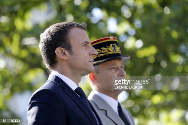 French President Emmanuel Macron and Chief of the Defence Staff French Army General Pierre de Villiers arrive aboard a command car for the annual...