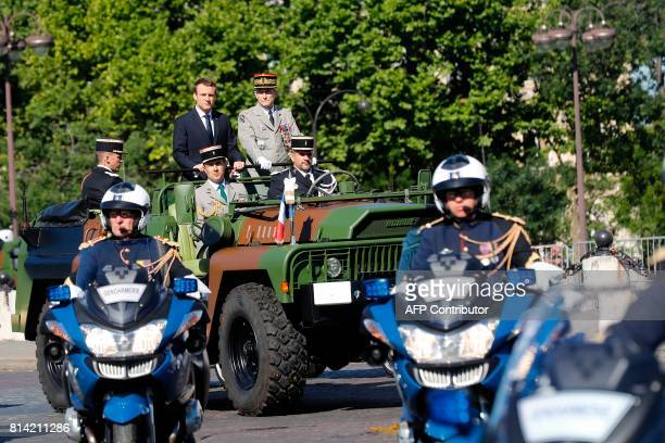 French President Emmanuel Macron and Chief of the Defence Staff French Army General Pierre de Villiers arrive for the annual Bastille Day military...