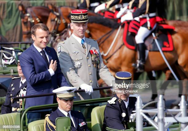 French President Emmanuel Macron and Chief of the Defence Staff French Army General Francois Lecointre arrive in a command car for the traditional...