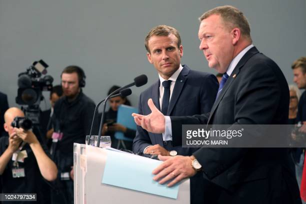 French President Emmanuel Macron and Denmark's Prime Minister Lars Lokke Rasmussen give a joint press conference following a meeting on August 28,...