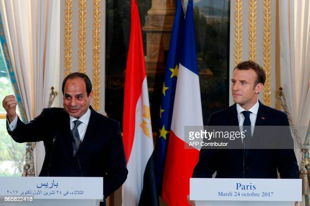 French President Emmanuel Macron and Egypt's President Abdel Fattah alSisi attend a press conference at the Elysee Palace in Paris on October 24 2017...