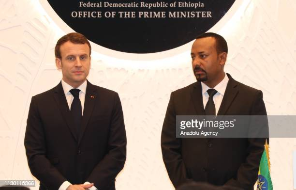 French President Emmanuel Macron and Ethiopia's Prime Minister Abiy Ahmed are seen after signing a memorandum of understanding following their...