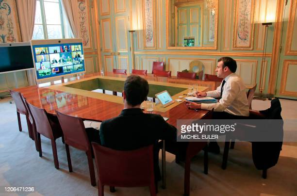 French President Emmanuel Macron and EU adviser Clement Beaune attend a video conference call with European leaders and with the European Council...