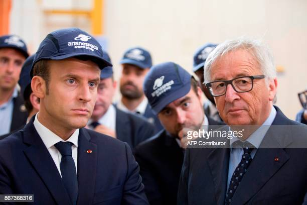 French President Emmanuel Macron and European Commission President JeanClaude Juncker visit the Guiana Space Centre in Kourou on October 27 2017 as...