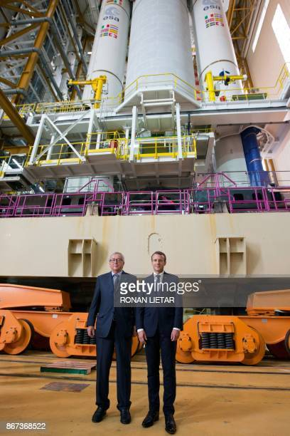 French President Emmanuel Macron and European Commission President JeanClaude Juncker pose for a photograph during a visit to the Guiana Space Centre...