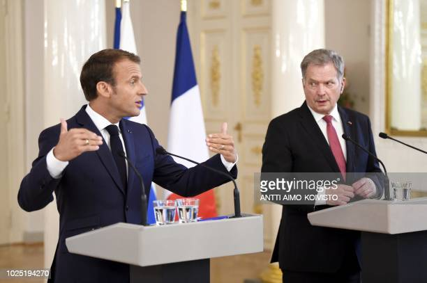 French President Emmanuel Macron and Finnish President Sauli Niinistö give a joint press conference at the Presidential Palace in Helsinki Finland on...