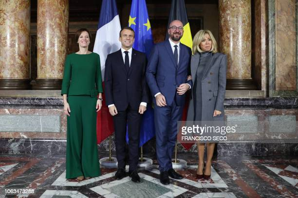 French President Emmanuel Macron and first lady Brigitte Macron pose with Belgian Prime Minister Charles Michel and his partner Amelie...
