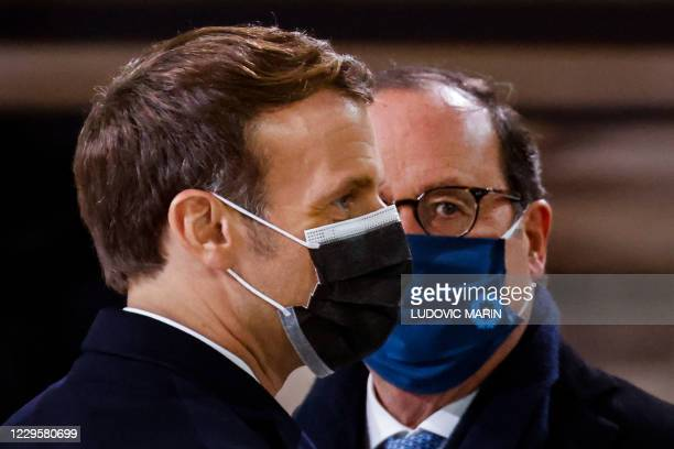 French President Emmanuel Macron and former French President Francois Hollande attend a ceremony at the Pantheon, honouring the World War I soldiers...