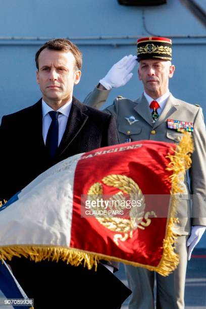 French President Emmanuel Macron and French Army Chief of Staff General Francois Lecointre stand at attention as they review French Navy personel...
