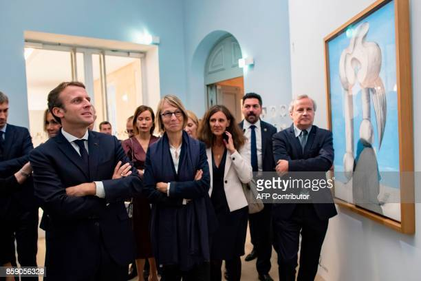 French President Emmanuel Macron and French Culture Minister Francoise Nyssen view Pablo Picasso's 1932 painting 'Figures by the Sea' during the...