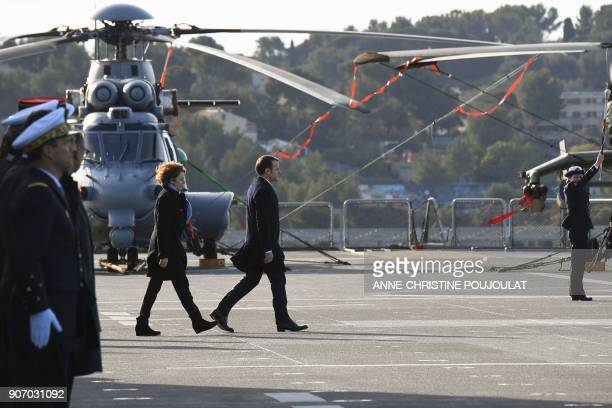 French President Emmanuel Macron and French Defence Minister Florence Parly arrive aboard the French Mistral Class assault ship and helicopter...