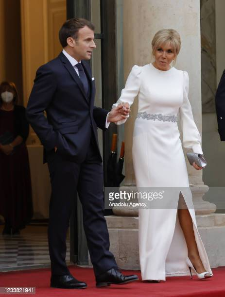 French President Emmanuel Macron and French First Lady Brigitte Macron are pictured before a state dinner with Italian President Sergio Mattarella at...