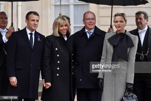 French President Emmanuel Macron and French First Lady Brigitte Macron welcome Albert II Prince of Monaco and his wife Charlene Princess of Monaco...