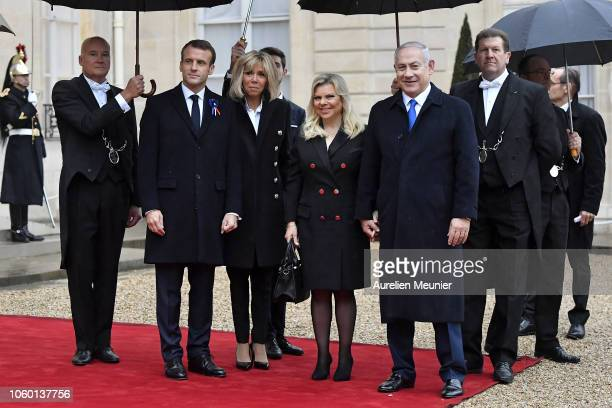 French President Emmanuel Macron and French First Lady Brigitte Macron , welcome Prime Minister of Israel Benjamin Netanyahu and his wife Sara...
