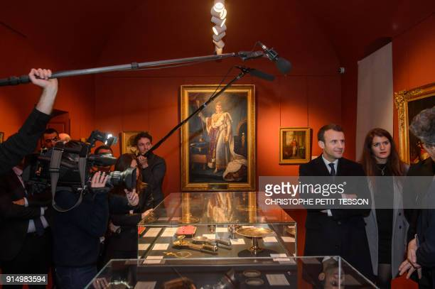 French President Emmanuel Macron and French Junior Minister for Gender Equality Marlene Schiappa stand near a portrait of Napoelon I as they visit...