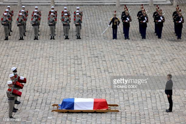 French President Emmanuel Macron and French Legionnaires carry the coffin of Hubert Germain during the national memorial service for him - the last...