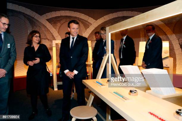 French President Emmanuel Macron and French Minister for Culture Françoise Nyssen listen to exhibition curator Astrid Aron as they visit the...