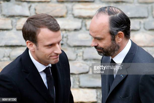 French President Emmanuel Macron and French Prime minister Edouard Philippe arrive to attend a solemn funeral ceremony for the Gendarme Colonel...