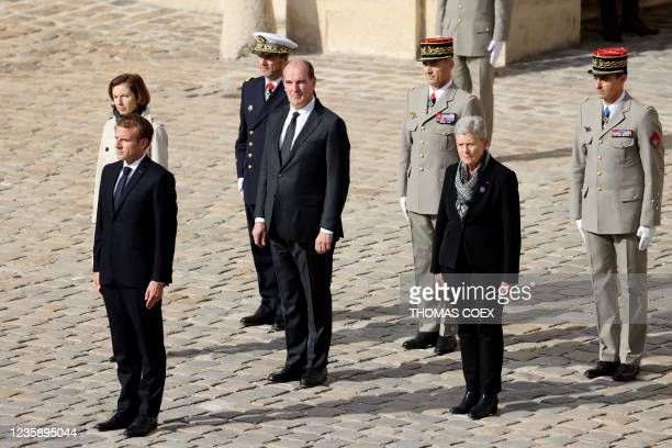 French President Emmanuel Macron and French Prime Minister Jean Castex stand during the national memorial service for Hubert Germain - the last...