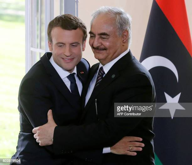 French President Emmanuel Macron and General Khalifa Haftar commander in the Libyan National Army attend a press conference after talks aimed at...