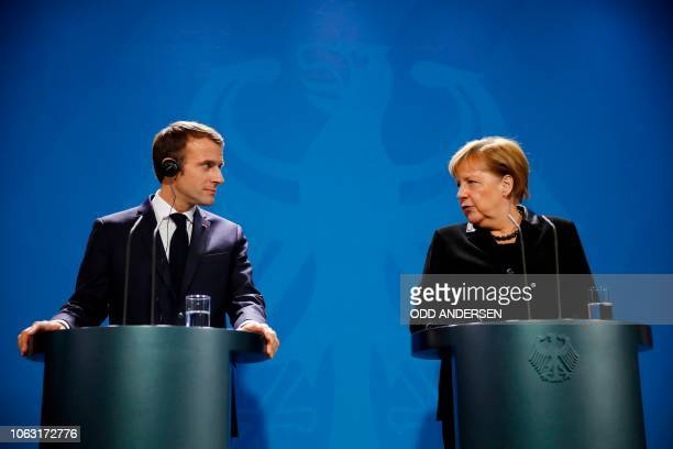French President Emmanuel Macron and German Chancellor Angela Merkel give a press statement prior to talks on November 18 2018 at the Chancellery in...