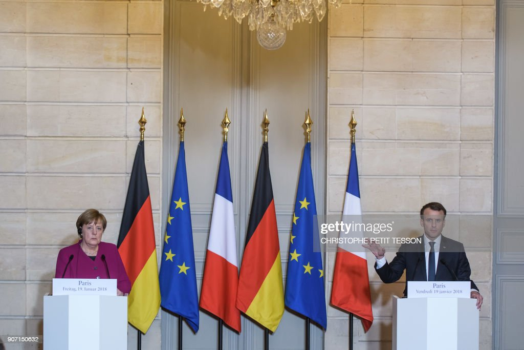 'Stable German government' crucial for EU to act says Angela Merkel after meeting Emmanuel Macron at the Elysee Palace