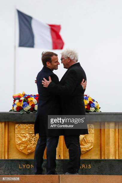 French President Emmanuel Macron and German President Frank-Walter Steinmeier embrace during the inauguration of the WWI French-German memorial of...