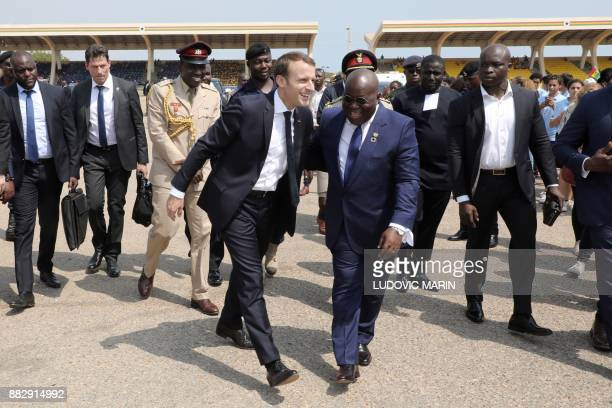 TOPSHOT French President Emmanuel Macron and Ghana's President Nana Akufo Addo attend a welcoming ceremony at the Independence square upon his...