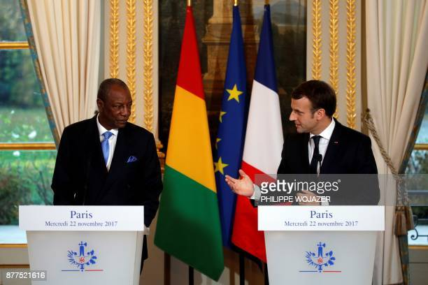 French President Emmanuel Macron and Guinea's President Alpha Conde hold a joint press conference following a meeting at the Elysee Palace in Paris...