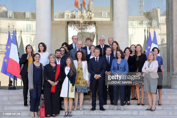 French President Emmanuel Macron and Health Minister Agnes Buzyn pose with the members of the commission entitled the child's first 1000 days on...