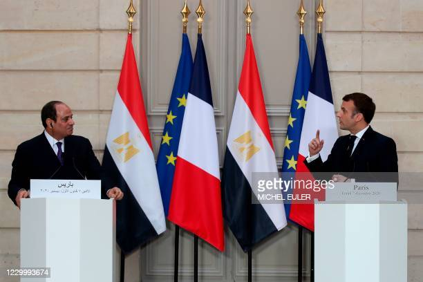 French President Emmanuel Macron and his Egyptian counterpart Abdel Fattah al-Sisi hold a press conference following their meeting at the Elysee...